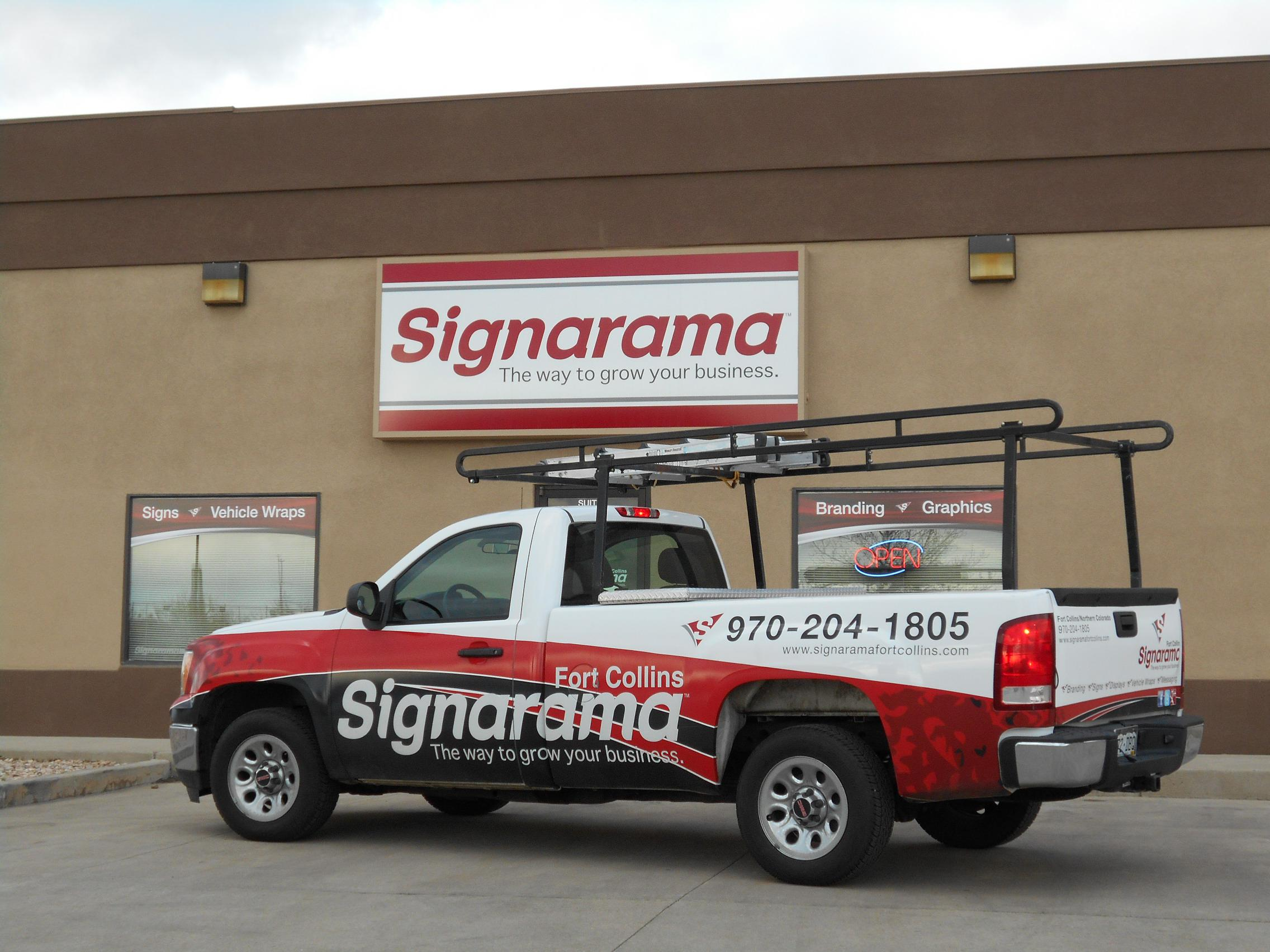 Partial Truck Wrap with Reflective Logo.JPG