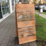 Custom acrylic panel with vinyl lettering on client-supplied wood sandwich board