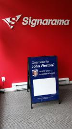Metal frame sandwich board with dry erase laminate and clear cover sheet